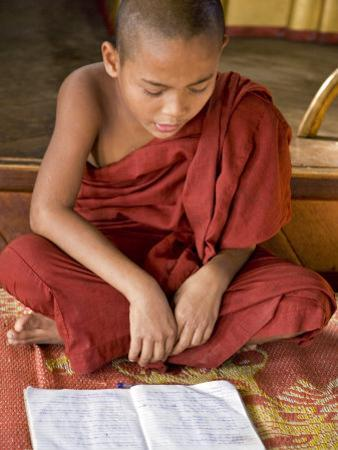 Burma, Lake Inle, A Young Novice Monk Learning at a Monastery School on Lake Inle, Myanmar by Nigel Pavitt