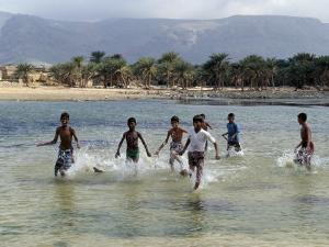 Children Enjoy a Boat Race in a Lagoon at Qalansiah, an Important Fishing Village in the Northwest by Nigel Pavitt