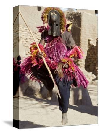 Dogon Country, Tereli, A Masked Dancer Leaps High in the Air at the Dogon Village of Tereli, Mali