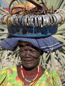 Himba Street Vendor at Opuwo Who Sells Himba Jewellery, Arts and Crafts to Passing Tourists by Nigel Pavitt