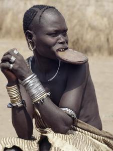 Mursi Woman Wearing a Large Clay Lip Plate, Omo Delta, Ethiopia by Nigel Pavitt