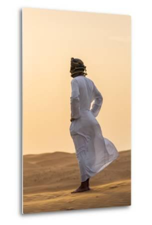 Oman, Wahiba Sands. an Omani Guide Enjoys the Sunset on Sand Dunes in Wahiba Sands.