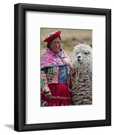 Peru, a Female with an Alpaca at Abra La Raya