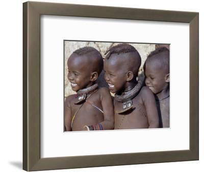 Three Happy Himba Children Enjoy Watching a Dance, Namibia
