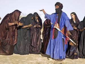 Timbuktu, A Group of Tuareg Men and Women Sing and Dance Near their Desert Home, Mali by Nigel Pavitt