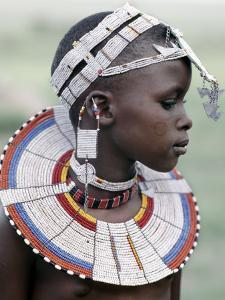 White Beadwork and Circular Scar on Cheek of This Maasai Girl, from the Kisongo Group by Nigel Pavitt