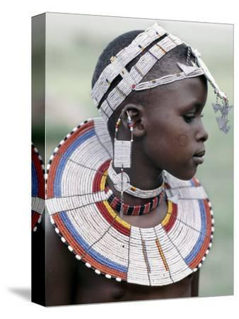 White Beadwork and Circular Scar on Cheek of This Maasai Girl, from the Kisongo Group