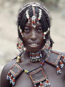 Young Afar Girl at Senbete Market, Her Elaborate Hairstyle and Beaded Jewellery by Nigel Pavitt