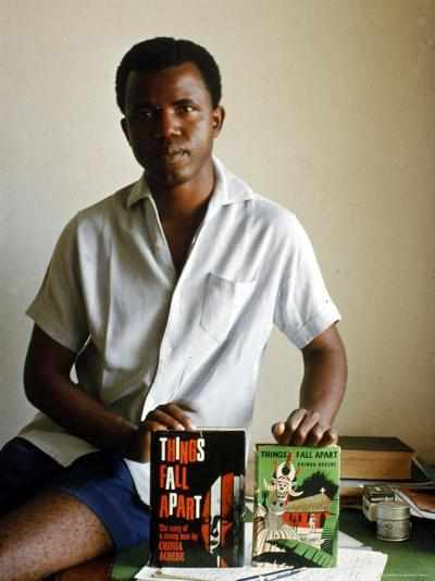 Nigerian Author Chinua Achebe Holding Two Editions of His Book Things Fall Apart-Eliot Elisofon-Premium Photographic Print
