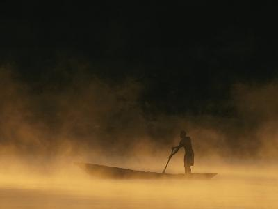 Night Fisherman in a Dugout Canoe on the Zambezi River-Chris Johns-Photographic Print