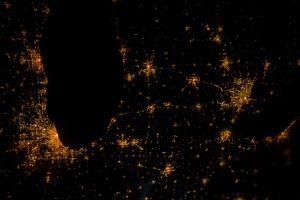 Night time satellite image of Chicago, Milwaukee, Detroit and Lake Michigan, Michigan, USA