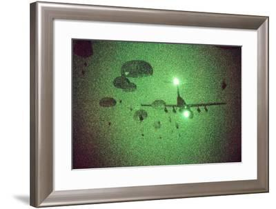 Night Vision Image of Paratroopers Jumping from C-141 Starlifter, Sept. 12 1989--Framed Photo
