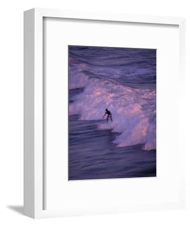 Surfer at Huntington Beach, Orange County, California