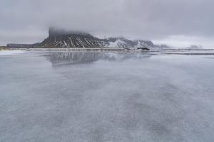 Large Ice in Front of a Mountain in Iceland by Niki Haselwanter
