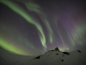Northern Lights over a Mountain in Iceland by Niki Haselwanter