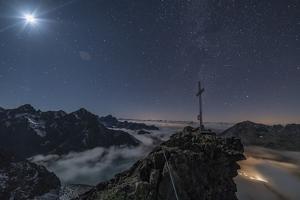 Summit Cross with Moon on Pockkogel in Kuhtai by Niki Haselwanter