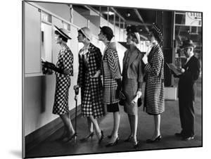 5 Models Wearing Fashionable Dress Suits at a Race Track Betting Window, at Roosevelt Raceway by Nina Leen