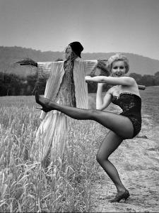"""Actress and Dancer Julie Newmar Warming Up for Her Devil's Role in the Musical """"Damn Yankees"""" by Nina Leen"""