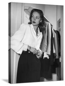 Actress Lauren Bacall at Gotham Hotel by Nina Leen