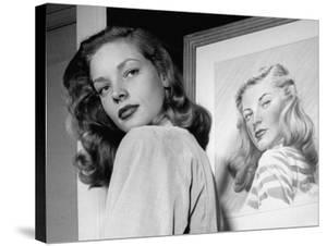 Actress Lauren Bacall Posing in Front of Portrait Drawing of Herself in Suite at the Gotham Hotel by Nina Leen