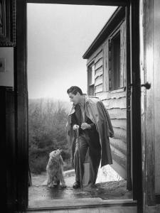 At Home Gian-Carlo Menotti Usually Sports a Cane When He Walks with His Dog by Nina Leen