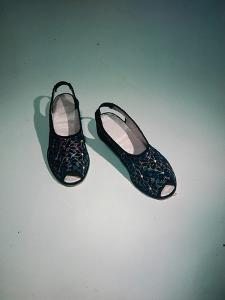 Best Selling Christmas Gifts - Peephole Shoes by Nina Leen