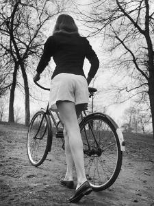 Bicycle Being Pushed by a Typical American Girl by Nina Leen