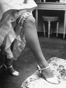 Bride Barbara Alvin Wearing a Blue Garter on Her Leg for Her Wedding by Nina Leen