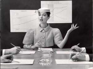 Business Woman Wearing Fashion That Gives Wide Shoulder Look by Nina Leen