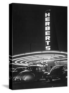 Cars Sitting Outside of a Drive-In Restaurant by Nina Leen