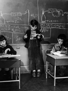 Children Studying Nuclear Physicist and Writing their Answers on the Board at the Age of 7 by Nina Leen
