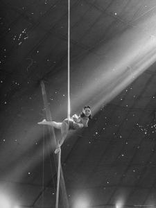 Circus Aerialist Bella Attardi, Hanging on Rope Practicing Aerial Ballet For Ringling Bros. Circus by Nina Leen