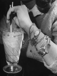 Close Up of Teenage Girl's Wrist Covered with Six Different Identification Bracelets by Nina Leen