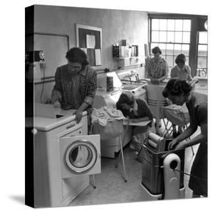 Cornell University Home Economics Students Learn the Characteristics of Commercial Washing Machines by Nina Leen