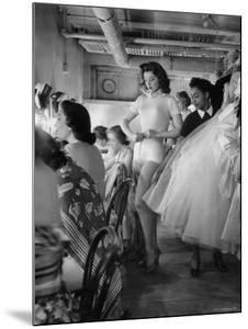 Debutante Actress Tina L. Meyer Changing Clothes Backstage in Dressing Room by Nina Leen