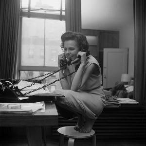 Eileen Ford, Co-Founder of the Ford Modeling Agency Taking Many Phone Calls, 1948 by Nina Leen