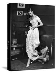 Eileen Ford Repairing a Gown So Model Barbara Mullen Can Wear it to a Party, New York, NY, 1948 by Nina Leen