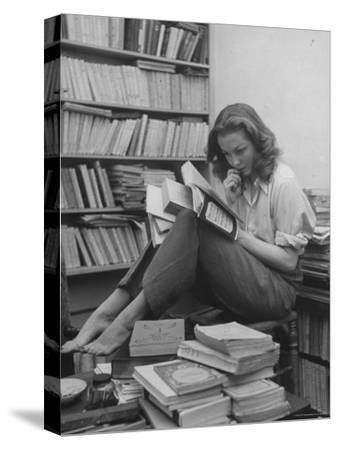French Actress Barbara Laage, Alone in Her Apartment Reading