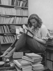 French Actress Barbara Laage, Alone in Her Apartment Reading by Nina Leen