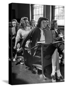 High School Student Passing Note to Classmate Sitting Behind Her by Nina Leen