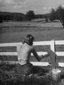 Lady Painting the Fence by Nina Leen