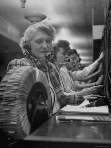 Line of Operators at Macy's Main Switchboard, with Alice Lennon Flipping Through a Rolodex File by Nina Leen