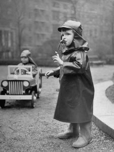 Little Boys at Play Wearing a Rainsuit by Nina Leen