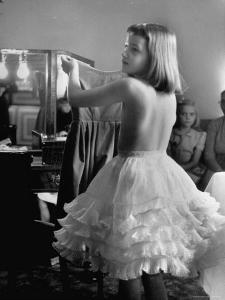 Little Girl Modeling at a Fashion Show by Nina Leen