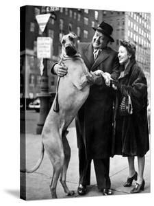 Metropolitan Opera's Helden Tenor Lauritz Melchior with Wife, Petting His Great Dane Dog on Street by Nina Leen