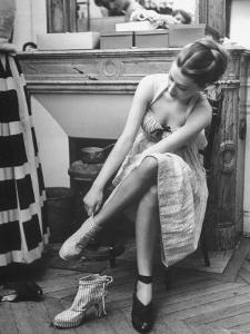 Model Changing Her Shoes For Pierre Balmain's Fashion Show by Nina Leen