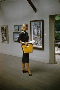 Model in a David Goodstein-Designed Outfit, Looks at Paintings in a Museum, New York, 1954 by Nina Leen