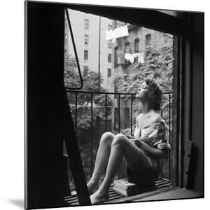 Model Jean Patchett on Fire Escape of Ford Modeling Agency, New York, New York, 1941 by Nina Leen