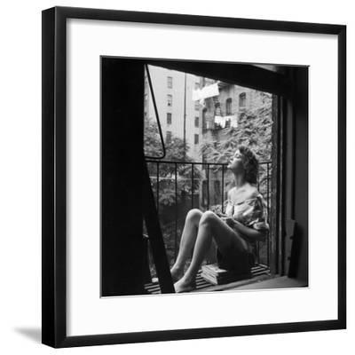 Model Jean Patchett on Fire Escape of Ford Modeling Agency, New York, New York, 1941