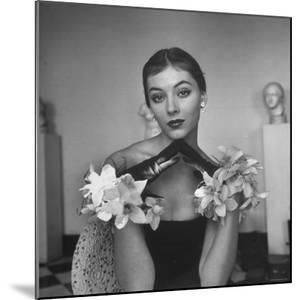 Model Wearing a Flowery Glove While Peering Into the Distance by Nina Leen